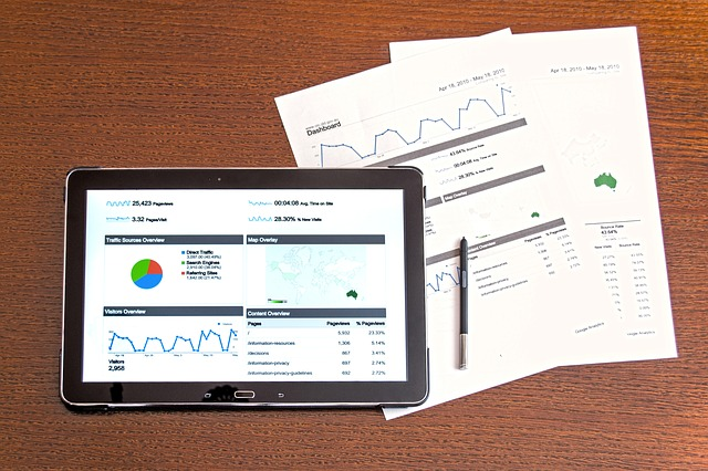 example of page from Google analytics on a tablet with 2 printed off sheets